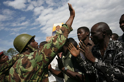 Kisumu, Kenya, January 16th 2008. Police stops ODM supporters on their way to central Kisumu for their party political rally. © Photo by Christophe Calais for The New York Times.